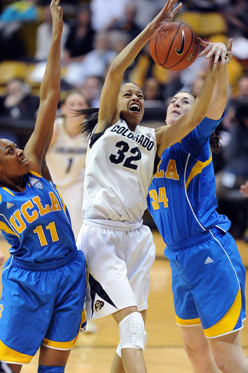 . Colorado\'s Arielle Roberson has her shot blocked from behind by UCLA\'s Corinne Costa during the second half of an NCAA college basketball game Friday, Feb. 28, 2014, in Boulder, Colo. Colorado won 62-42. (AP Photo/Daily Camera, Cliff Grassmick)