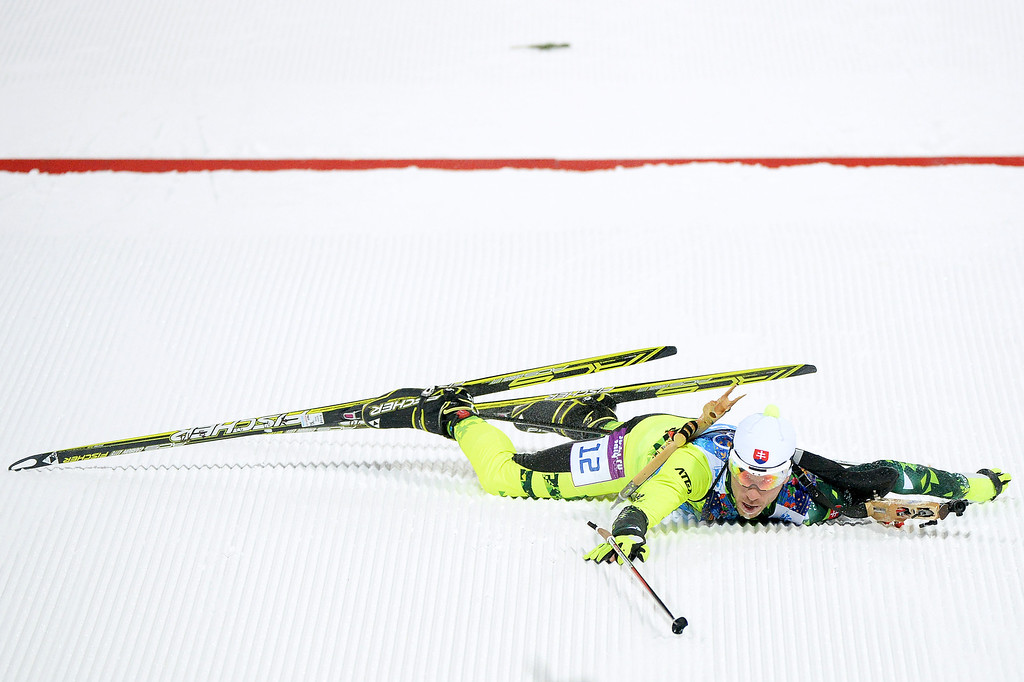 . Matej Kazar of Slovakia falls over the finishing line in the 2 x 6 km Women + 2 x 7 km Men Mixed Relay during day 12 of the Sochi 2014 Winter Olympics at Laura Cross-country Ski & Biathlon Center on February 19, 2014 in Sochi, Russia.  (Photo by Harry How/Getty Images)