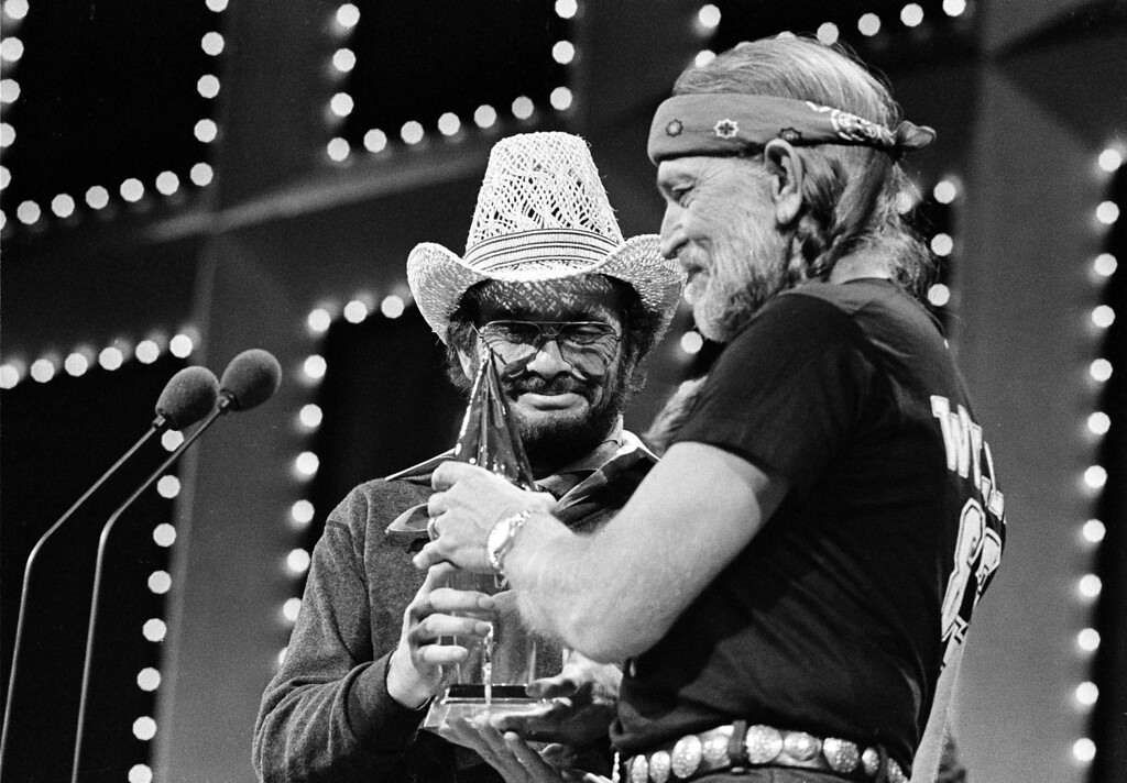 . Merle Haggard, left, and Willie Nelson accept their Duo of the Year award at the Country Music Association Awards in Nashville, Tenn., Oct. 10, 1983.  (AP Photo/Mark Humphrey)