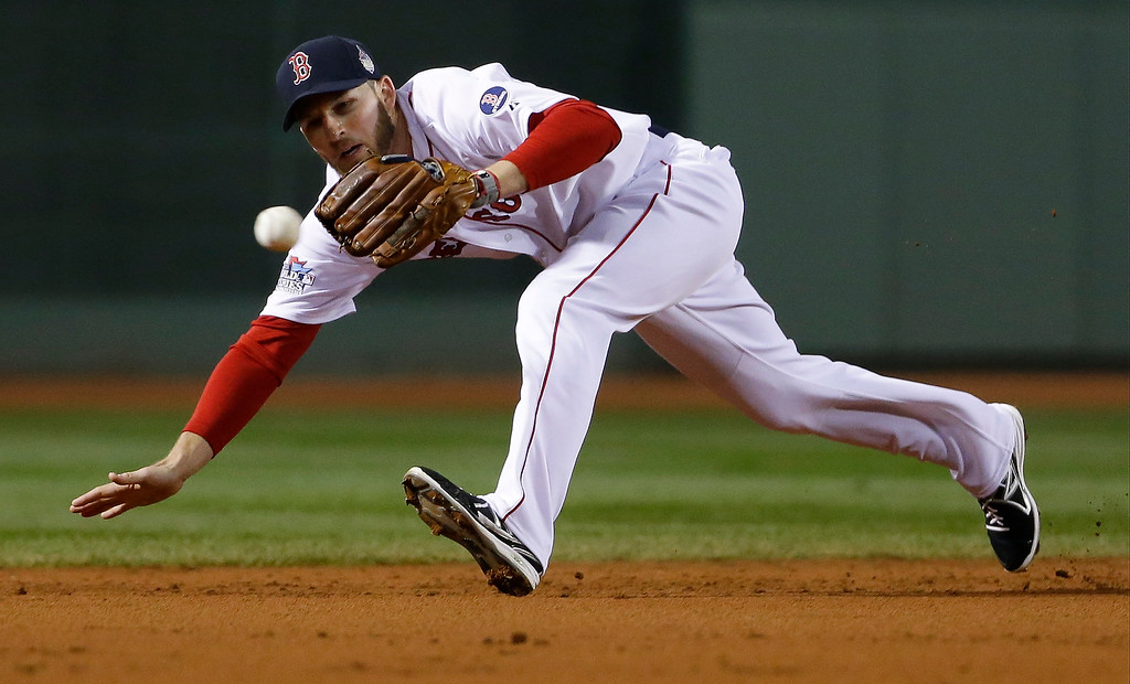. Boston Red Sox shortstop Stephen Drew can not make the play on a single by St. Louis Cardinals catcher Yadier Molina during the second inning of Game 6 of baseball\'s World Series Wednesday, Oct. 30, 2013, in Boston. (AP Photo/Matt Slocum)