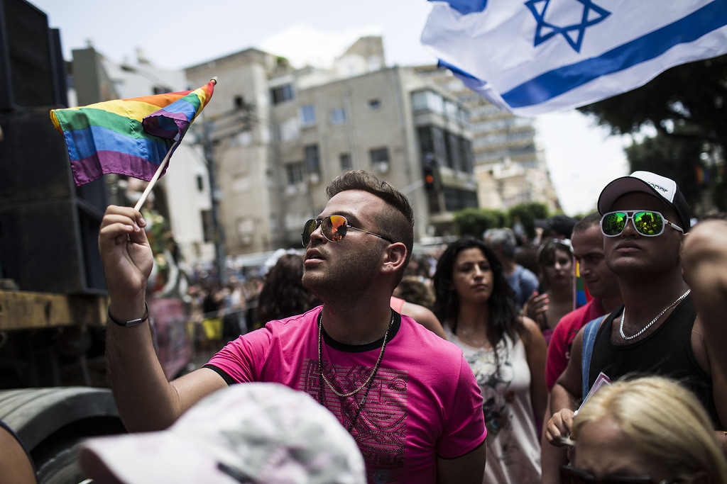 . People take part in the annual Tel Aviv Gay Pride parade on June 7, 2013 in Tel Aviv, Israel.  (Photo by Ilia Yefimovich/Getty Images)