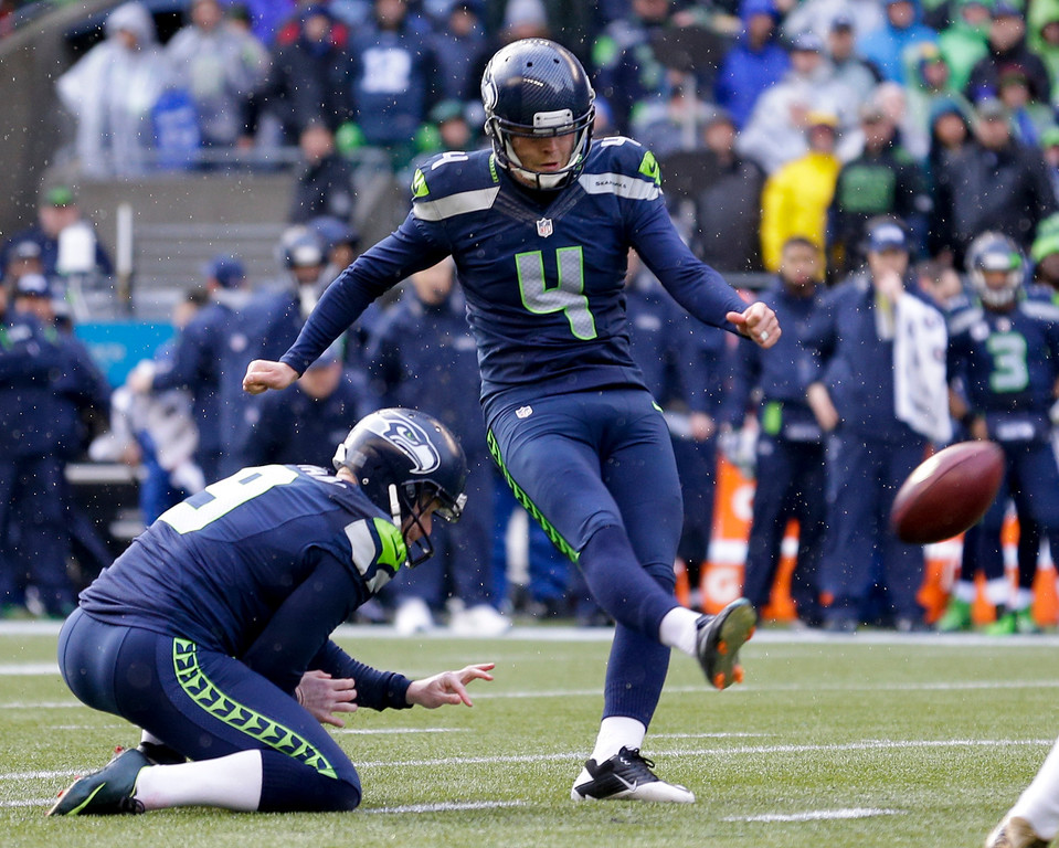 . Seattle Seahawks\' Steven Hauschka, right, kicks a 38-yard field goal from the hold of Jon Ryan against the New Orleans Saints during the first quarter of an NFC divisional playoff NFL football game in Seattle, Saturday, Jan. 11, 2014. (AP Photo/Ted S. Warren)