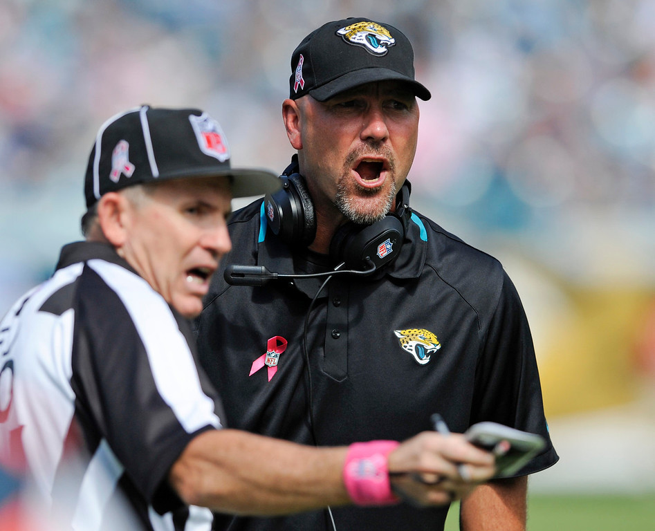 . Jacksonville Jaguars head coach Gus Bradley, right, argues a call with an official during the first half of an NFL football game against the San Diego Chargers in Jacksonville, Fla., Sunday, Oct. 20, 2013.(AP Photo/Stephen Morton)