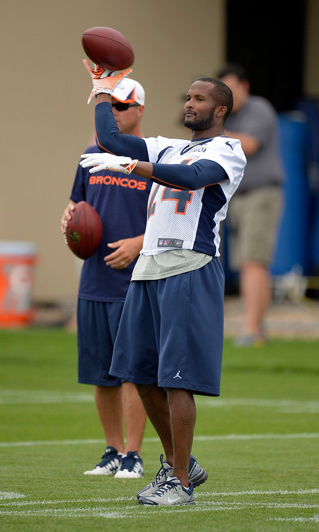 . Denver Broncos cornerback Champ Bailey (24) helps out with drills during practice September 1, 2013 at Dove Valley. (Photo by John Leyba/The Denver Post)