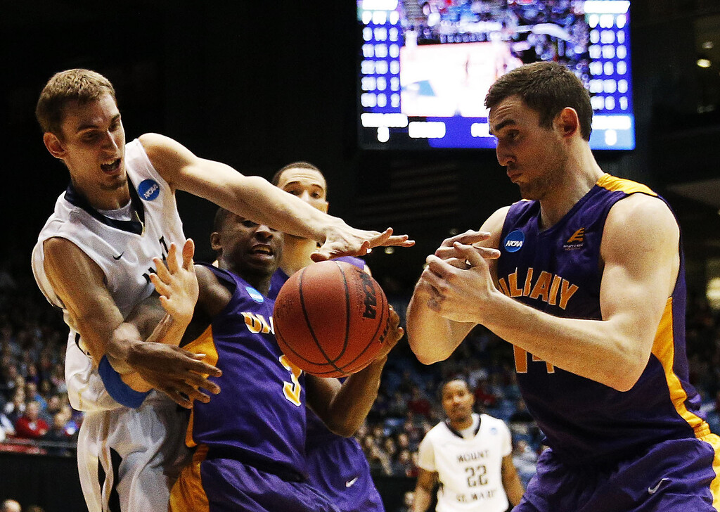 . Taylor Danaher #50 of the Mount St. Mary\'s Mountaineers vies for a looseball with DJ Evans #3 and Sam Rowley #14 of the Albany Great Danes in the second half during the first round of the 2014 NCAA Men\'s Basketball Tournament at at University of Dayton Arena on March 18, 2014 in Dayton, Ohio.  (Photo by Gregory Shamus/Getty Images)