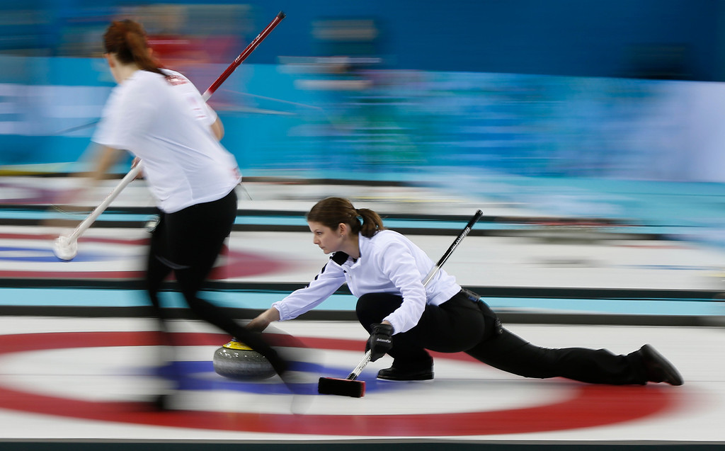 . Denmark\'s skip Lene Nielsen delivers the rock during women\'s curling competition against the United States at the 2014 Winter Olympics, Friday, Feb. 14, 2014, in Sochi, Russia. (AP Photo/Robert F. Bukaty)