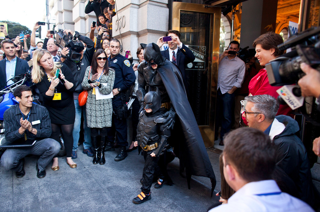 . 5-year-old leukemia survivor Miles, also known as BatKid and Batman leave a former bank after arresting the Riddler November 15, 2013 in San Francisco. Make-A-Wish Greater Bay Area foundation turned the city into Gotham City for Miles by creating a day long event bringing his wish to be a BatKid to life. (Photo by Ramin Talaie/Getty Images)