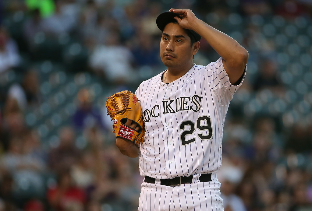 . DENVER, CO - AUGUST 14:  Starting pitcher Jorge De La Rosa #29 of the Colorado Rockies pauses between batters as he works against the Cincinnati Reds at Coors Field on August 14, 2014 in Denver, Colorado.  (Photo by Doug Pensinger/Getty Images)