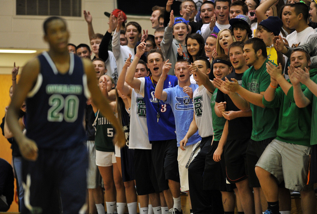 . HIGHLANDS RANCH, CO. - MARCH 02: ThunderRidge High School students celebrate the turnover during the 2nd round of 5A playoff game against Overland High School at ThunderRidge High School. March 2, 2013. Highlands Ranch, Colorado. ThunderRidge won 67-57. (Photo By Hyoung Chang/The Denver Post)