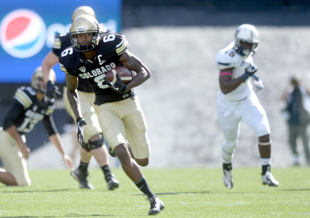 . University of Colorado\'s Paul Richardson runs in for a touchdown after making a catch during a game against Charleston Southern on Saturday, Oct. 19, at Folsom Field in Boulder.  (Jeremy Papasso/Boulder Daily Camera)