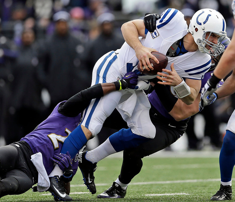 . Baltimore Ravens cornerback Corey Graham (24) and outside linebacker Paul Kruger (99) sack Indianapolis Colts quarterback Andrew Luck (12) during the first half of an NFL wild card playoff football game Sunday, Jan. 6, 2013, in Baltimore. (AP Photo/Patrick Semansky)