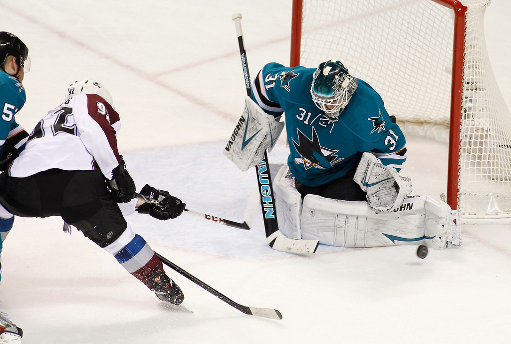 . San Jose Sharks goalie Antti Niemi blocks a shot by Colorado Avalanche\'s Gabriel Landeskog during the second period of an NHL hockey game, Monday, Dec. 23, 2013, in San Jose, Calif. At far left is Sharks\' Matt Irwin. (AP Photo/George Nikitin)