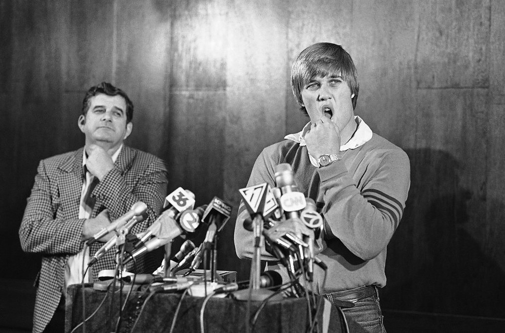 . This April 26, 1983, file photo shows Stanford university quarterback John Elway announcing that he\'ll play baseball for the New York Yankees rather than sign with the Baltimore Colts, as his father Jack looks on, during a news conference in San Jose, Calif.  The rest as Denver Broncos fans will tell you, is history. (AP Photo/Paul Sakuma, File)