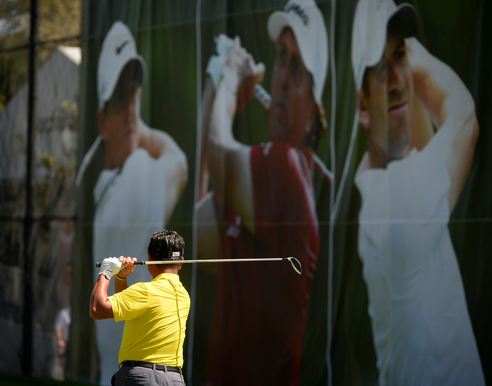 . CHERRY HILLS VILLAGE, CO. - SEPTEMBER 02:  Professional golfer, K.J. Choi, hits a few ball on the driving range at the FedExCup BMW Championship at the Cherry Hills Country Club Tuesday, September 02, 2014 (Photo By Andy Cross / The Denver Post)