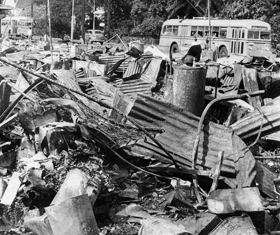 . A mass of twisted metal wreckage lay along a Honolulu street after the city had been attacked by Japanese planes Dec. 7, 1941. (AP Photo)