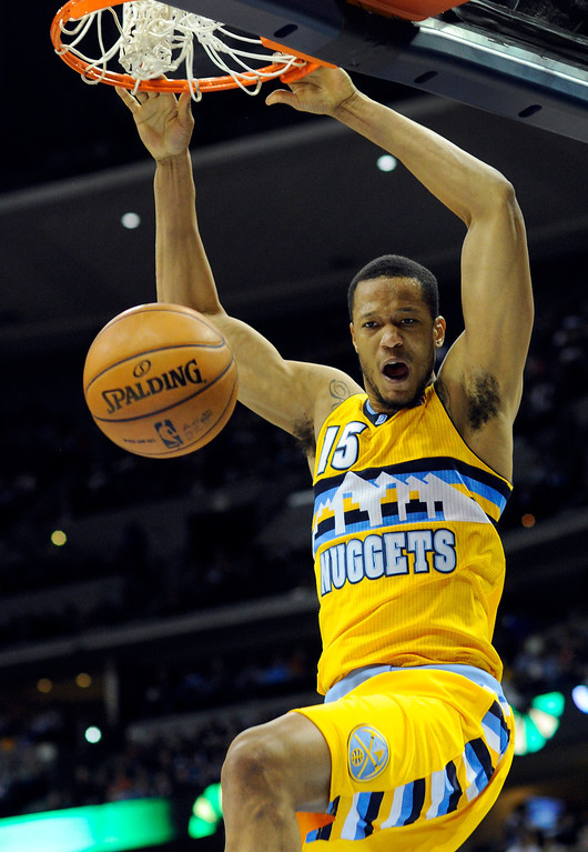 . DENVER, CO. - MARCH 21: Anthony Randolph (15) of the Denver Nuggets finished a fast break with an exclamation point. The Denver Nuggets defeated the Philadelphia 76ers 101-100 Thursday night, March 21, 2013 at the Pepsi Center. The Nuggets are on a 14-game record winning streak that is a team record. (Photo By Karl Gehring/The Denver Post)