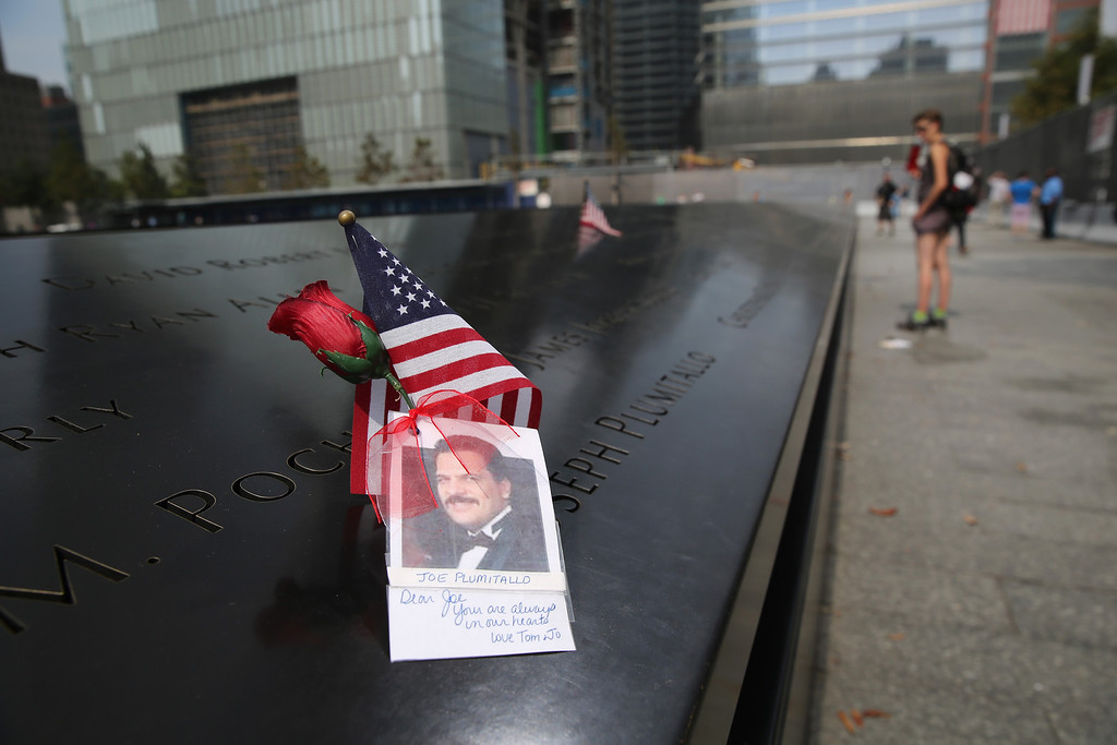 . NEW YORK, NY - SEPTEMBER 10:  A photograph of a 9/11 victim lies atop the 9/11 Memorial on September 10, 2013 in New York City. Tomorrow marks the 12th anniversary of the attacks of September 11, 2001 that killed almost 3,000 people. The 9/11 Memorial has become a major tourist attraction for visitors to New York City.  (Photo by John Moore/Getty Images)