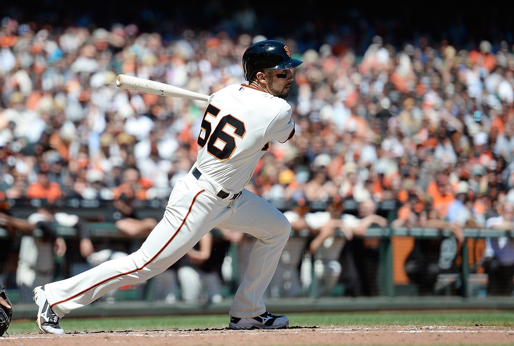 . Andres Torres #56 of the San Francisco Giants hits a bases loaded single driving in two runs against the Colorado Rockies in the bottom of the second inning at AT&T Park on April 10, 2013 in San Francisco, California.  (Photo by Thearon W. Henderson/Getty Images)