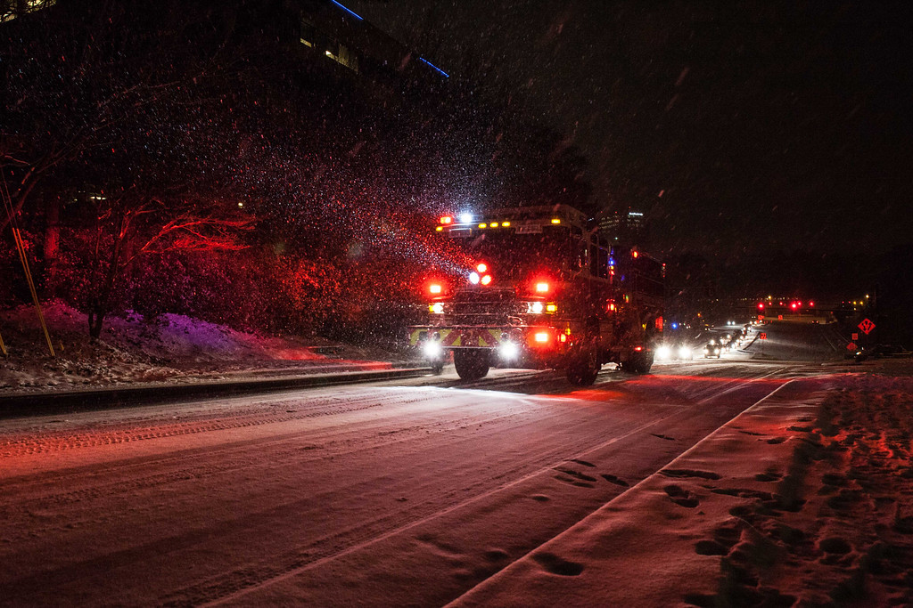 . A firetruck drives up an icy road late Tuesday, Jan. 28, 2014, in Dunwoody, Ga. Around Atlanta, nearly all public entities and most businesses were shut down early Wednesday, and officials encouraged would-be motorists not to drive. (AP Photo/Branden Camp)