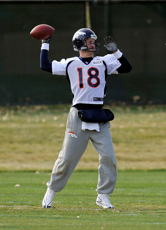 . Denver Broncos quarterback Peyton Manning (18) throws down field during practice November 4, 2013 at Dove Valley. Manning was wearing the gloves on a brisk day. (Photo by John Leyba/The Denver Post)