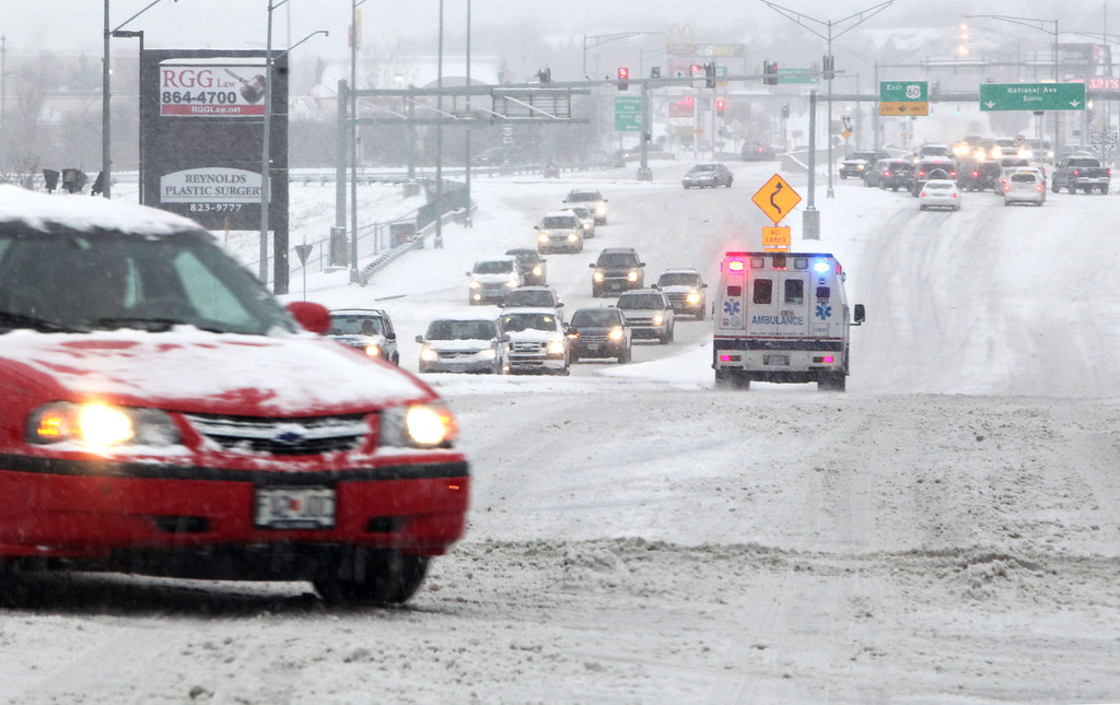 . Traffic moved slowly around along S. National Ave. and Highway 60 on Friday morning, Dec. 6, 2013, in Springfield, Mo. Winter storm and ice warnings are in effect through much of today for parts of six states in the Midwest, including Texas, Missouri, Illinois and Indiana. (AP Photo/The Springfield News-Leader, Valerie Mosley)