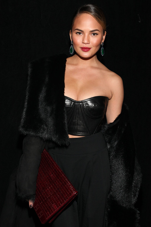 . Model Chrissy Teigen attends the DKNY 30th Anniversary fashion show during Mercedes-Benz Fashion Week on Monday, Feb. 10, 2014, in New York. (Photo by Omar Vega/Invision/AP)