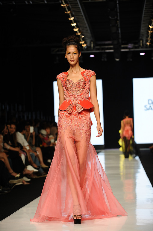 . A model showcases designs by Dhanny Satriadi on the runway at the Indonesian Fashion Designer Council show during Jakarta Fashion Week 2014 at Senayan City on October 21, 2013 in Jakarta, Indonesia.  (Photo by Robertus Pudyanto/Getty Images)
