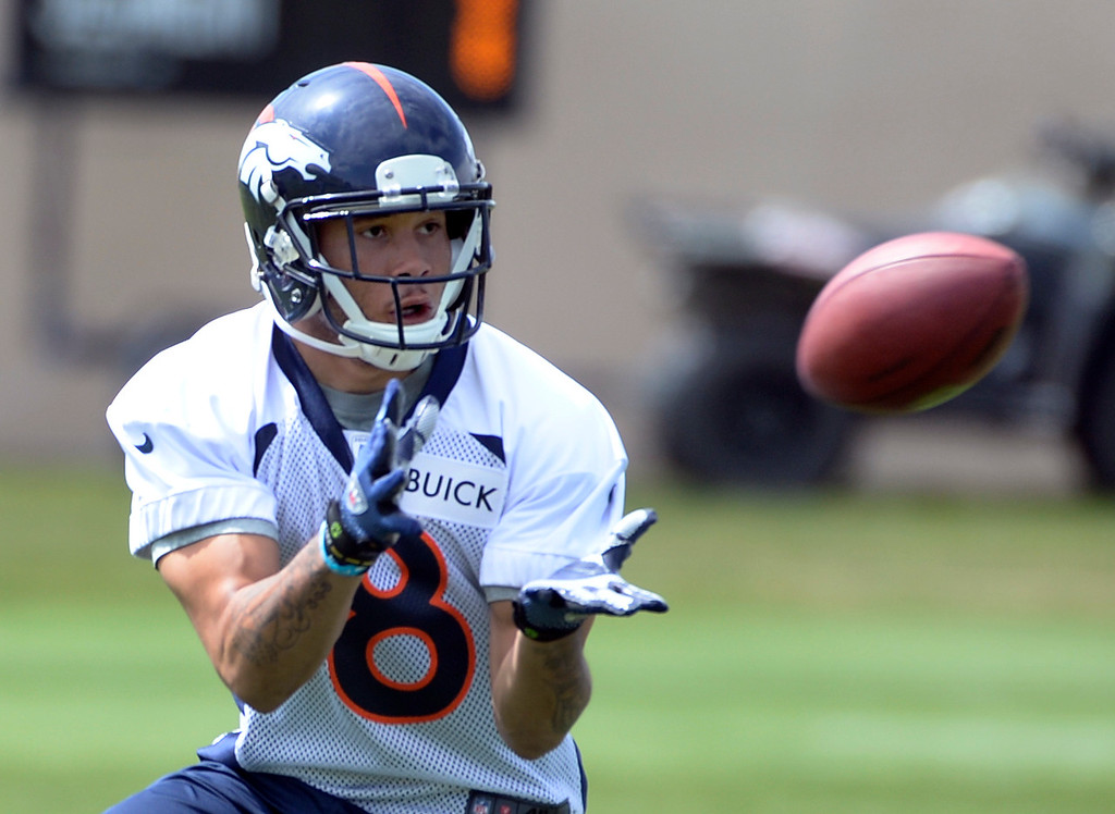 . Devin Aguilar (8) runs through drills with fellow rookies as the Denver Broncos host their rookie minicamp at Dove Valley in Englewood on Friday, May 16, 2014.  (Kathryn Scott Osler, The Denver Post)
