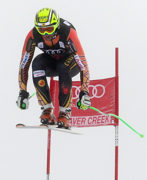 . Canada\'s Manuel Osborne-Paradis flies off the last jump during the men\'s World Cup downhill skiing event, Friday, Dec. 6, 2013, in Beaver Creek, Colo. (AP Photo/Charles Krupa)