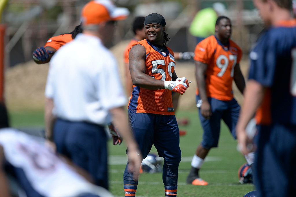 . Denver Broncos Danny Trevathan (59) stretches during OTAs June 11, 2014 at Dove Valley. (Photo by John Leyba/The Denver Post)