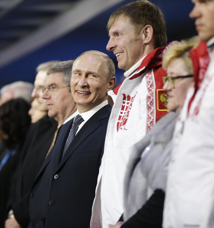 . Russian President Vladimir Putin, (4th L) stands next to Alexander Zubkov (3rd L), gold medalist in the two-man and four-man bobsled for Russia, during the 2014 Sochi Winter Olympics Closing Ceremony at Fisht Olympic Stadium on February 23, 2014 in Sochi, Russia.  (Photo by David Goldman-Pool/Getty Images)