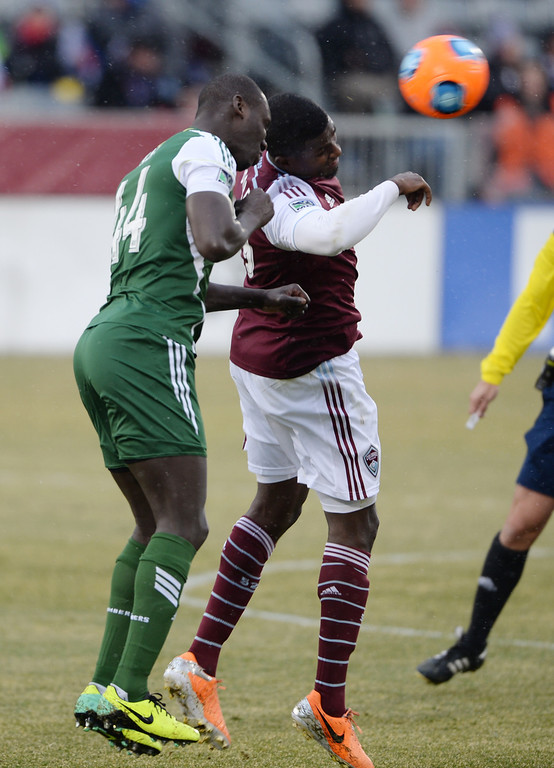 . COMMERCE CITY MARCH 22: Edson Buddle of Colorado Rapids (9), right, and Pa Modou Kah of Portland Timbers (44) fight for the control of ball in the 1st half of the game at Dick\'s Sporting Goods Park. Commerce City, Colorado. March 22. 2014. Colorado won 2-0. (Photo by Hyoung Chang/The Denver Post)