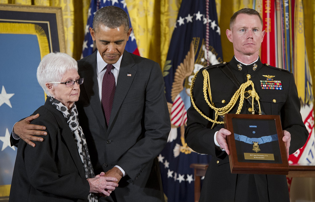 . US President Barack Obama presents Nancy Weinstein with a Medal of Honor for her late husband Army Sergeant Jack Weinstein during a ceremony in the East Room of the White House in Washington on March 18, 2014. Obama awarded the Medal of Honor to 24 veterans, 3 of whom are still living, who fought in World War II, the Korean War and the Vietnam War, most of whom were previously denied the prestigious honor due to their Hispanic, black or Jewish backgrounds. The ceremony results from a Pentagon review of Jewish and Hispanic war records ordered by Congress in 2002.     AFP PHOTO / Saul LOEB/AFP/Getty Images