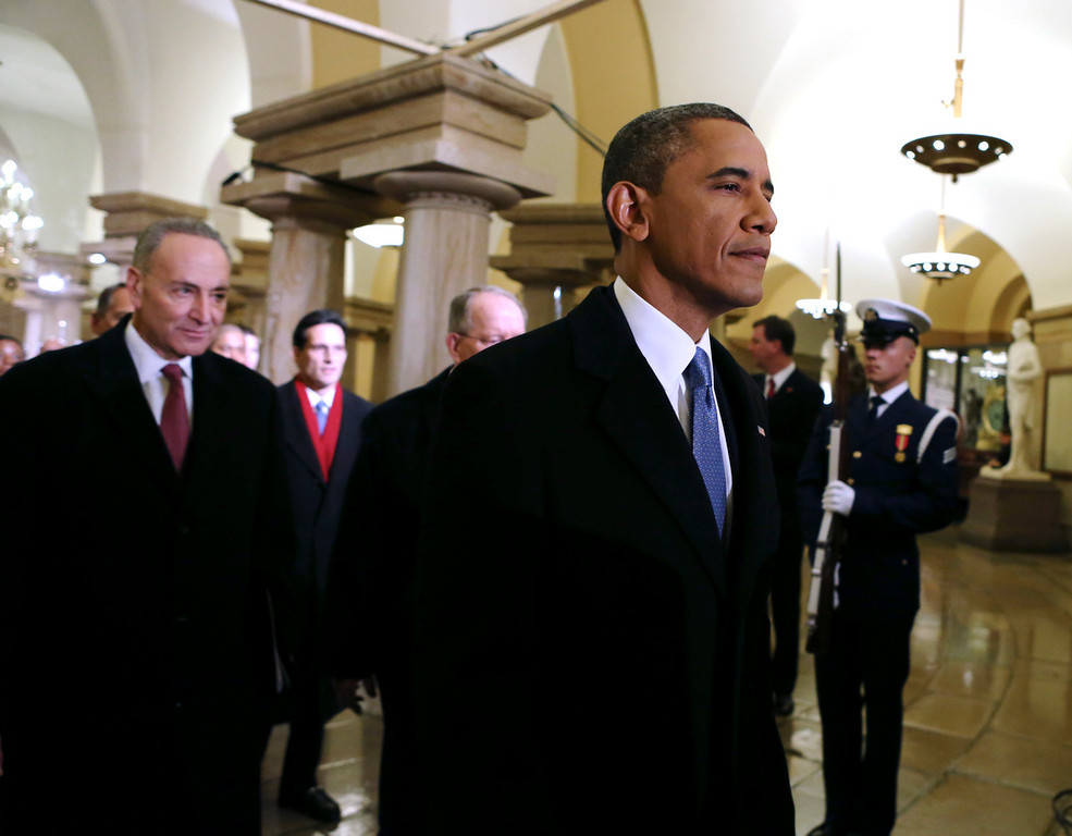 . President Barack Obama, followed by, form left, Sen. Charles Schumer, D-N.Y., left, chairman of the Joint Congressional Committee on Inaugural Ceremonies, House Majority Leader Eric Cantor of Va., and Sen. Lamar Alexander, R-Tenn., walks through the  Capitol in Washington, Monday, Jan. 21, 2013, for his ceremonial swearing-in ceremony during the 57th Presidential Inauguration. (AP Photo/Molly Riley, Pool)