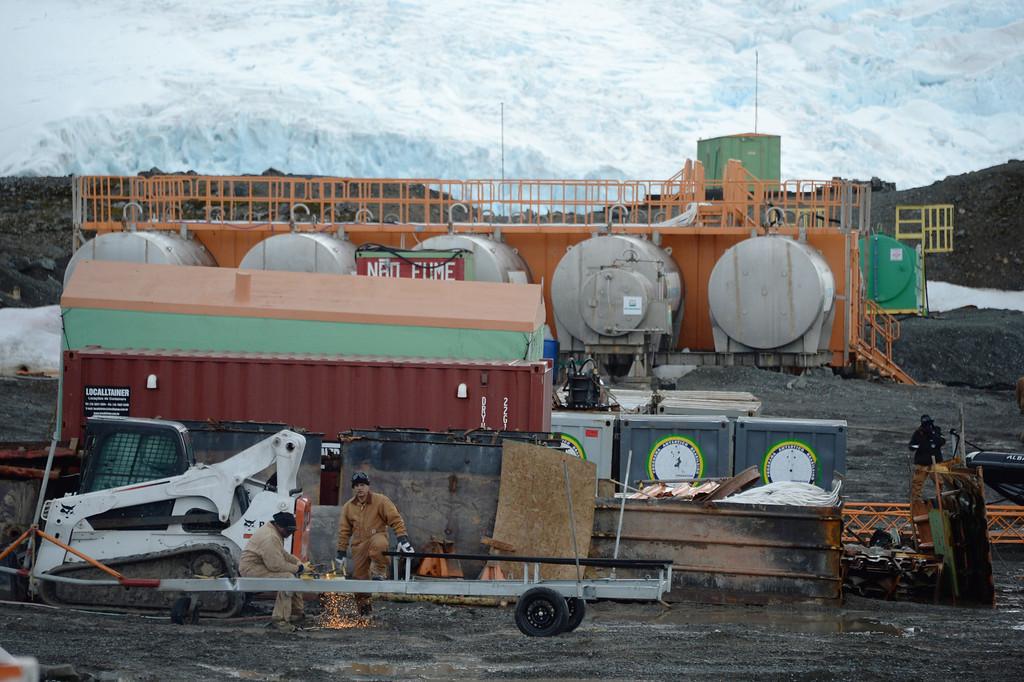 . Brazilian Navy personnel work near the Brazilian Comandante Ferraz Antarctic station on March 10, 2014.    AFP PHOTO / VANDERLEI ALMEIDA /AFP/Getty Images