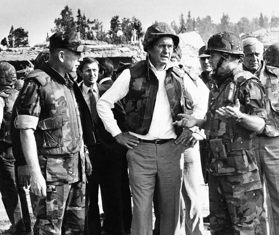 . In this Oct. 26, 1983 file photo, U.S. Vice President George Bush, center, wearing a flak jacket and steel helmet, is briefed at the site of  a suicide truck bomb attack on the U.S. Marine barracks, near Beirut airport, Lebanon. At left is Marine Corps Commandant Gen. Paul Kelly and right is Col. Timothy Geraghty. The blast _ the single deadliest attack on U.S. forces abroad since World War II _ claimed the lives of 241 American service members.(AP Photo, File)