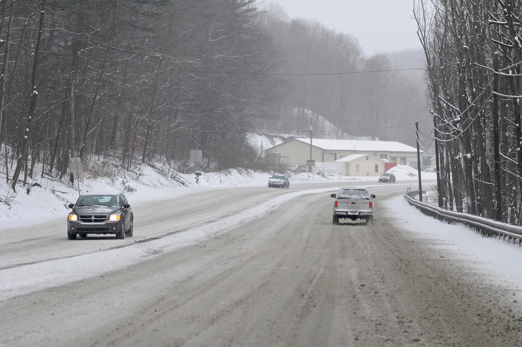 . Snow and slush cover Rt. 209 looking south on The Pottsville Maroons Highway in Branch Township, Pa., Tuesday, Jan. 21, 2014. The National Weather Service has issued a winter storm warning for Tuesday\'s storm with public schools closed in parts of central Pennsylvania and elsewhere.    (AP Photo/ The Republican-Herald, Jacqueline Dormer)
