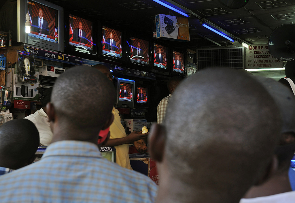 . People on a street watch on television sets  in a shop Kenya\'s president-elect, Uhuru Kenyatta\'s speech after he was declared winner on March 9, 2013 of a presidential election in Nairobi. AFP PHOTO/Tony KARUMBA/AFP/Getty Images