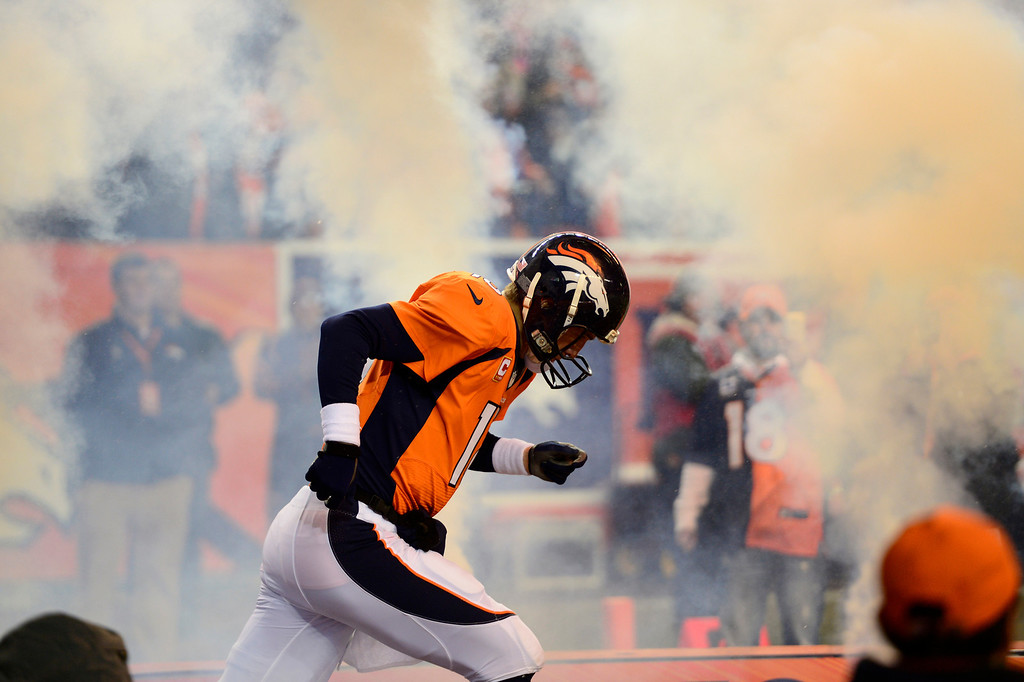. Denver Broncos quarterback Peyton Manning (18) running out on the field at the start of the game. The Denver Broncos vs. the San Diego Chargers at Sports Authority Field at Mile High in Denver on December 12, 2013. (Photo by AAron Ontiveroz/The Denver Post)