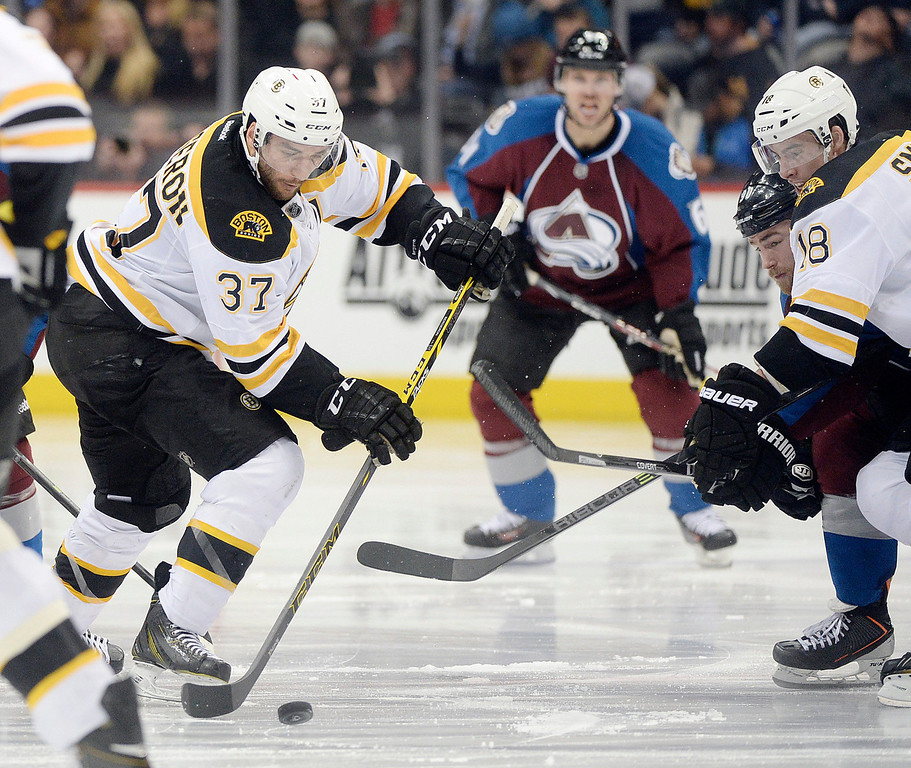. Boston center Patrice Bergeron (37) worked with the puck in the third period. The Boston Bruins blanked the Colorado Avalanche 2-0 at the Pepsi Center Friday night, March 21, 2014. (Photo by Karl Gehring/The Denver Post)