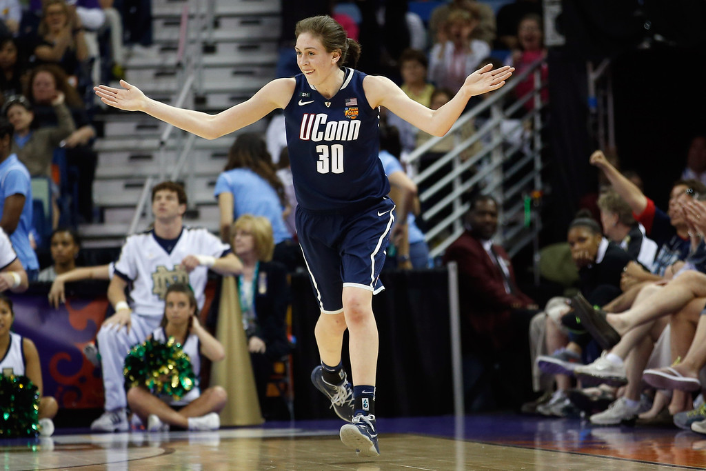 . Breanna Stewart #30 of the Connecticut Huskies reacts to a three point shot against the  Notre Dame Fighting Irish during the National Semifinal game of the 2013 NCAA Division I Women\'s Basketball Championship at the New Orleans Arena on April 7, 2013 in New Orleans, Louisiana.  (Photo by Chris Graythen/Getty Images)