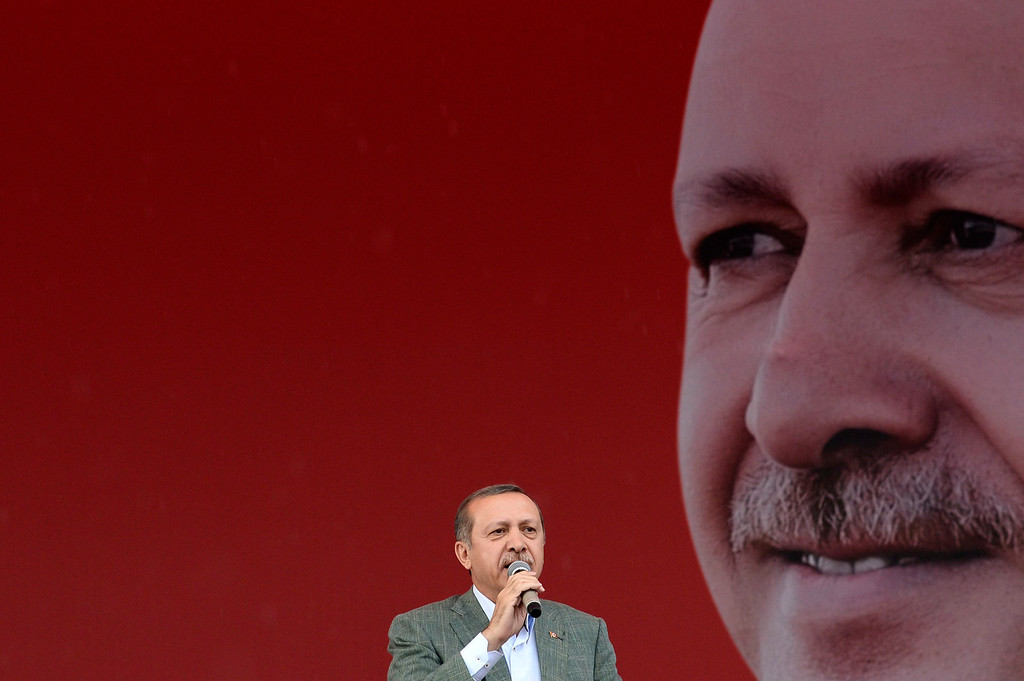 . Turkey\'s Prime Minister Tayyip Erdogan addresses his supporters during a rally organized by his Justice and Development Party in Ankara June 15, 2013. Erdogan warned protesters occupying a central Istanbul park that they should leave before a ruling party rally on Sunday or face eviction by the security forces. REUTERS/Stringer