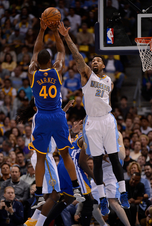 . Golden State Warriors small forward Harrison Barnes (40) puts up a shot over Denver Nuggets shooting guard Wilson Chandler (21) in the second quarter. The Denver Nuggets took on the Golden State Warriors in Game 5 of the Western Conference First Round Series at the Pepsi Center in Denver, Colo. on April 30, 2013. (Photo by John Leyba/The Denver Post)