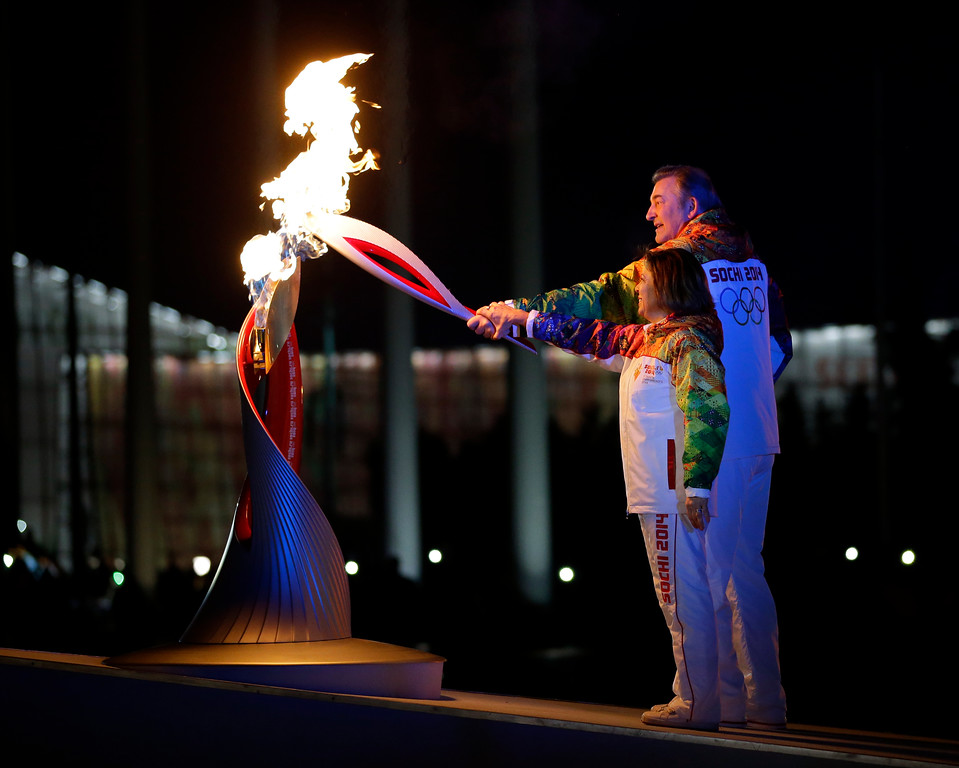 . Irina Rodnina and Vladislav Tretiak light the Olympic cauldron during the opening ceremony of the 2014 Winter Olympics in Sochi, Russia, Friday, Feb. 7, 2014. (AP Photo/Matt Slocum, Pool)