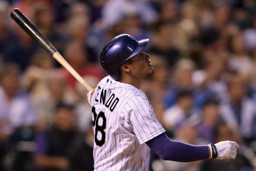 . DENVER, CO - MAY 03:  Nolan Arenado #28 of the Colorado Rockies hits a grand slam home run off of starting pitcher Jenrry Mejia #58 of the New York Mets to give the Rockies a 8-6 lead in the fifth inning at Coors Field on May 3, 2014 in Denver, Colorado. The hit also continues Arenado\'s league leading 23 consecutive game hit streak.  (Photo by Doug Pensinger/Getty Images)