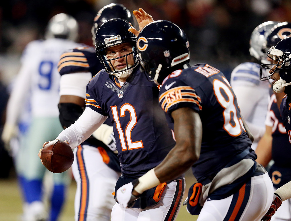 . Quarterback Josh McCown #12 celebrates a second quarter touchdown with tight end Martellus Bennett #83 of the Chicago Bears against the Dallas Cowboys during a game at Soldier Field on December 9, 2013 in Chicago, Illinois.  (Photo by Jonathan Daniel/Getty Images)