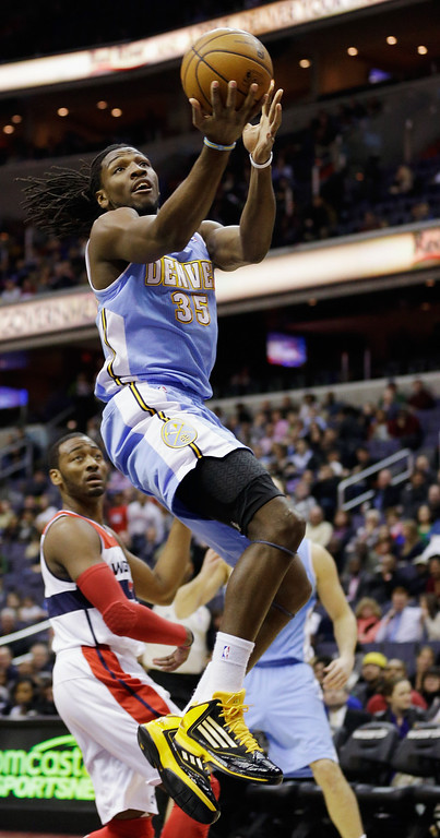 . WASHINGTON, DC - FEBRUARY 22: Kenneth Faried #35 of the Denver Nuggets puts up a shot in front of John Wall #2 of the Washington Wizards during the first half at Verizon Center on February 22, 2013 in Washington, DC.(Photo by Rob Carr/Getty Images)