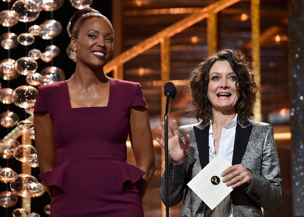 . TV personalities Aisha Tyler (L) and Sara Gilbert speak onstage during The 41st Annual Daytime Emmy Awards at The Beverly Hilton Hotel on June 22, 2014 in Beverly Hills, California.  (Photo by Alberto E. Rodriguez/Getty Images for NATAS)