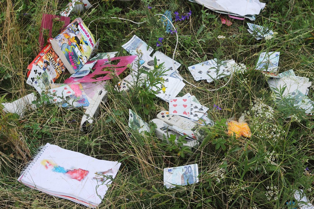 . A picture taken on July 18, 2014 shows belongings of passengers on the site of the crash of the Malaysia Airlines jet carrying 298 people from Amsterdam to Kuala Lumpur a day after it crashed, near the town of Shaktarsk, in rebel-held east Ukraine. Pro-Russian rebels fighting central Kiev authorities claimed on July 17 that the Malaysian airline that crashed in Ukraine had been shot down by a Ukrainian jet. All 298 people on board Flight MH17 died when the plane crashed. AFP PHOTO /DOMINIQUE  FAGET/AFP/Getty Images