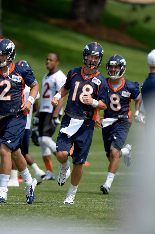 . ENGLEWOOD, CO. - JUNE 13: Peyton Manning (18) QB of the Denver Broncos heads to drills during the last day of minicamp June 13, 2013 at Dove Valley. (Photo By John Leyba/The Denver Post)